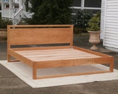Solid Hardwood Platform Bed with Head Board and Beam above Head Board and at head and foot bottoms, natural color