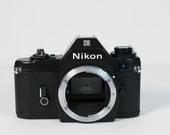 Vintage Nikon EM 35mm camera body - for parts/repair