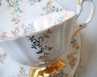 Queen Anne Teacup and Saucer, White with Blue Flowers