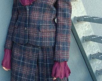 Tartan suit with statement blouse