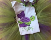 1st birthday sea turtle bodysuit with name, colorful tutu, and matching hair bow