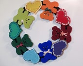 Painted wooden wall wreath of Teddy Bears in rainbow colors