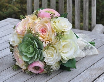 Wedding Bouquet made with a Succulent, Pink Roses, Yellow Roses, Eucalyptus Berries and Lemon Leaf by Holly's Wedding Flowers.