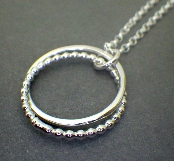 2 interlocking rings 3 4 silver beaded necklace 20th