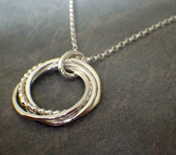 4 interlocking rings 3 4 silver beaded necklace by