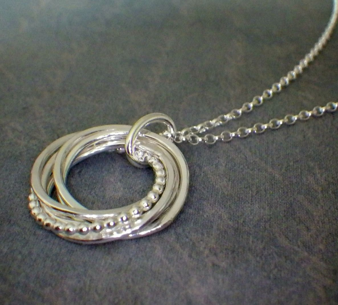 6 interlocking rings 3 4 silver beaded necklace by