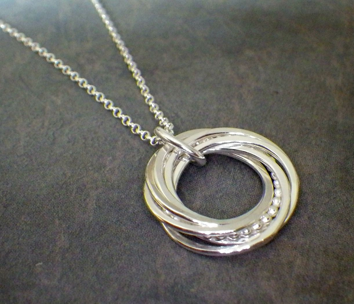 7 interlocking rings 3 4 silver beaded necklace by