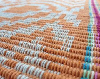 Orange rep weave rug