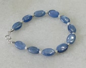 Blue kyanite bracelet with faceted spacers for women