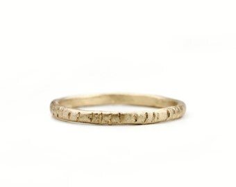 A bark textured wedding band. Twigs.