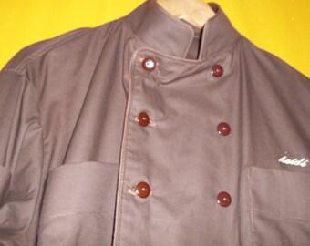 Custom Made Triple Choclate, six pocket Chef Coat. Handmade from heavy cotton, has six pocket ( 2 sleeve), fold back sleeves and monogrammed