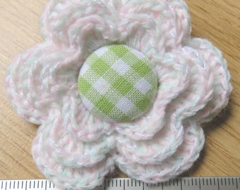 Irish crochet flower brooch in very pale pink and green wool with gingham button centre