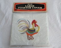 Nevco Large Toaster Cover With Embroidered Rainbow Roster Package Never opened.