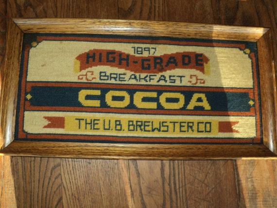 Vintage Framed Needlepoint Sampler Tapestry  of an  Advertisement Sign for Breakfast Cocoa in Solid Oak Frame in Good Vintage Condition