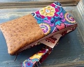 Faux ostrich and punch print wristlet
