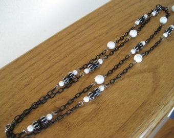 Bohemian black and white beaded chain necklace.