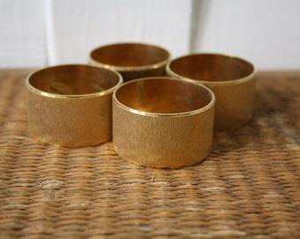 Vintage brass napkin rings, set of four, Hollywood Regency