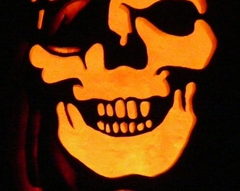 Pirate skull hand carved  on a foam pumpkin for Halloween decorating