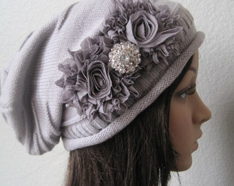 Grey Knit Slouch Beanie With Charcoal Grey Chiffon Flowers and a Faux Rhinestone Accent