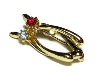 Wishbones brooch, gold tone lucky double wishbones pin with a red rhinestone and a blue rhinestone, looks like a stylized cat also
