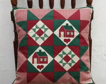 Cushion cover in red, green and white shades