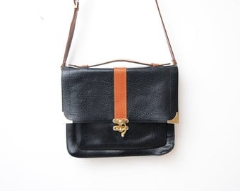 Vintage black leather shoulder messenger bag with orange details and golden buckle