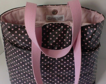 Waterproof tote bag , magnetic closure  and a zippered pocket inside