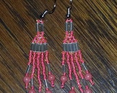 Beautiful hand woven glass bead earrings with natural coral accents