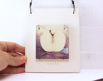Apple.   Polaroid Transfer Printed On Hand-Built Fired Clay Slab.  Layered Sewn Ceramic Slabs. Alternative Photography Process.