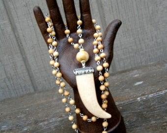 "Long Tibetan Horn Tusk Pendant Necklace on on rosary strung bone beads -  31"" long // boho // biker // rocker // Gwyneth Paltrow style"