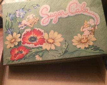Vintage cardboard box with fairies