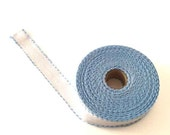 3 cm wide AIDA  BAND 16 Count blue border. White Cross stitch fabric with light blue border per 50 cm. Made in Europe. Cotton fabric.