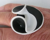 White and black swirly wavy big ring with elastic band/ Fimo (polymer clay) ring one side black other white sewn with beads on elastic band