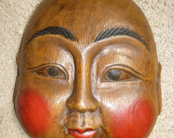 Cheerful and charming carved wood decorative mask - Rosy cheeked smiling face with Buddhist or Cherub overtones - fun and unusual form