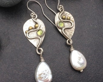 Light green peridot and white freshwater pearl earrings, hanging drop shaped solid sterling silver with brass balls