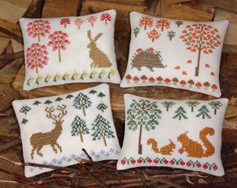 4 PDF primitive cross stitch sampler patterns: Seasons in Forest - Spring, Summer, Autumn and Winter