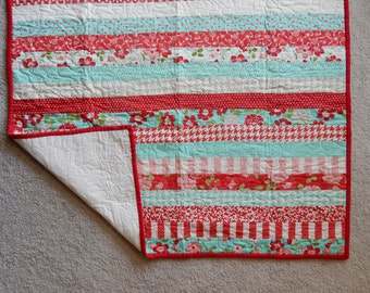 Red & aqua striped crib quilt