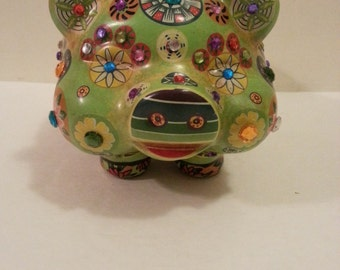 Green Piggy Bank with Decorative Accents