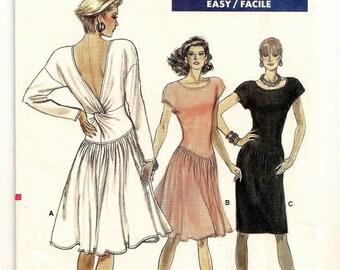 A Pullover, Dropped Waist, Straight/Flared Skirt, Cap/Long Sleeve, Back Twist Drape Dress Pattern for Women: Uncut-Sizes 6-8-10 • Vogue 7154