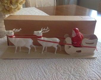 Wonderful 50's vintage glitter covered Christmas sleigh and Santa
