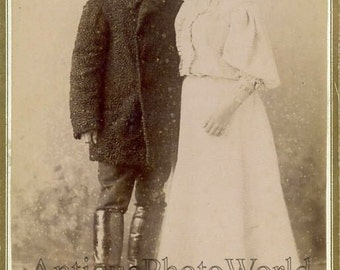 Russia mustached man with wife antique cabinet photo