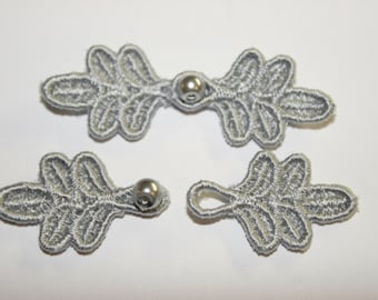 """1 3/4"""" Small Frog Closures, pkg of 2. PEWTER #R31. Machine Embroidered."""