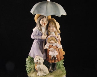 Porcelain figurine of two girls