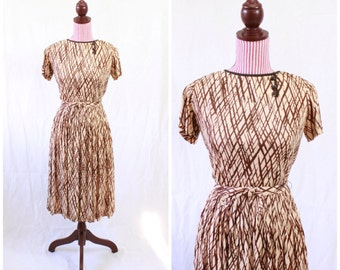 Vintage 1950s Dress / Atomic print / Rayon Jersey / 50s dress