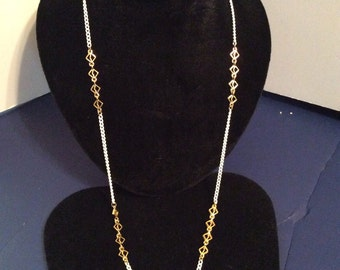 White and gold toned necklace 30 in