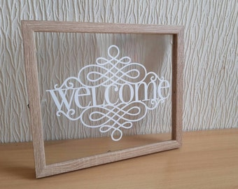 Welcome papercut in a floating frame