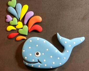 Fondant whale with colorful water spouts cake topper