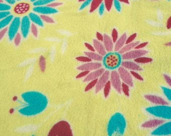 lovey blanket in a bright yellow and a turquoise back and satin binding