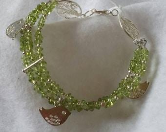 """Peridot 7.5 """" Triple-strand Gemstone Bracelet with bird charms"""