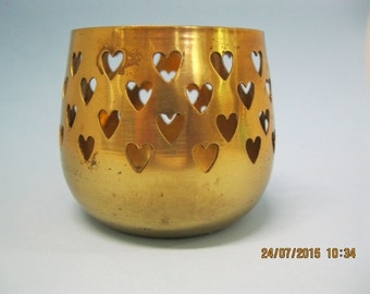 Vintage brass candle holder cup with cutout hearts used